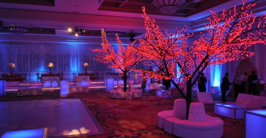 Lighted cherry trees with white banquette copy